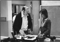 Photograph of Dr. Lee Clendenning and a student in a drafting/graphic arts class,...