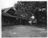 Photograph of Atlanta Hall from the left side, with Louise Cottage on the right,...