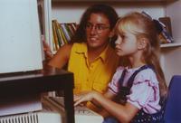 Photograph of Bonner volunteer Mandy Zimmerman helping an elementary student...